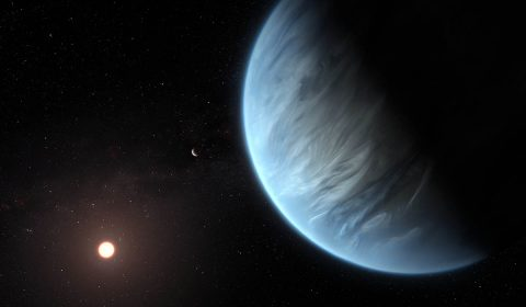 This artist's impression shows the planet K2-18b, its host star and an accompanying planet in this system. K2-18b is now the only super-Earth exoplanet known to host both water and temperatures that could support life. (ESA/Hubble, M. Kornmesser)