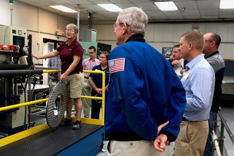 "Retired NASA astronaut Col. William ""Bill"" McArthur, along with NASA and Northrop Grumman personnel, view a test splice of the material used for an elastomer sealing at Parker Hannifin Corp., in Lexington, Kentucky, Sept. 18. Parker Hannifin's O-ring and Engineered Seals Division provides elastomer sealing that is a key component for NASA's Space Launch System rocket boosters. (NASA)"