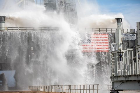 About 450,000 gallons of water poured onto the Pad B flame deflector, the mobile launcher flame hole and onto the launcher's blast deck during NASA's water flow test. (NASA/Frank Michaux)