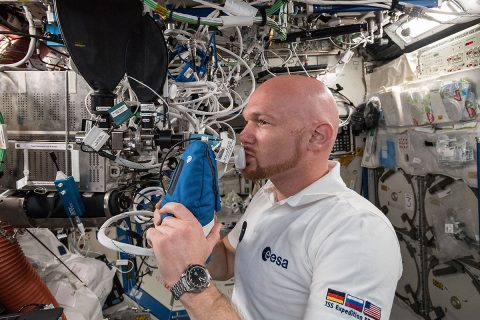 Astronaut Alexander Gerst exhales into an ultra-sensitive gas analyzer for the Airway Monitoring experiment. (NASA)