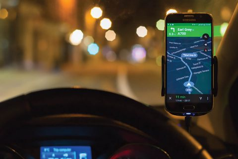 Google Maps Navigation software running as an app on a Samsung S6 smartphone, mounted above a car dashboard to provide driving directions. (NASA)