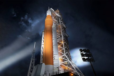 Artist's concept of the Space Launch System rocket and Orion capsule prepared for launch. (NASA)