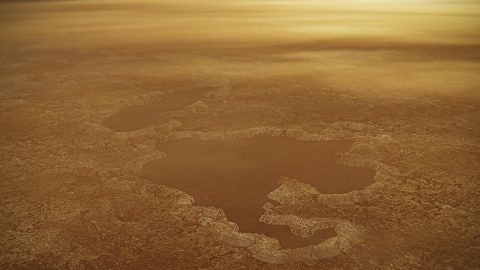 This artist's concept of a lake at the north pole of Saturn's moon Titan illustrates raised rims and rampartlike features such as those seen by NASA's Cassini spacecraft around the moon's Winnipeg Lacus. (NASA/JPL-Caltech)