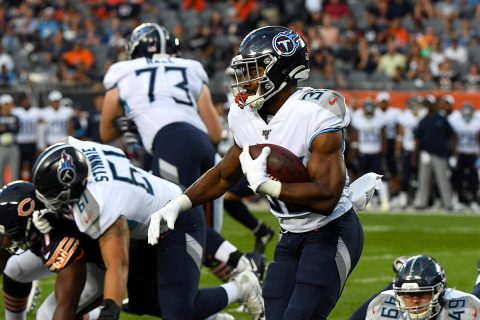 Tennessee Titans running back Jeremy McNichols (30) rushes the ball against the Chicago Bears during the first half at Soldier Field. (Mike DiNovo-USA TODAY Sports)