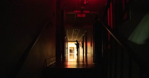 One of the ghost hunt team members explores Harned. (APSU)