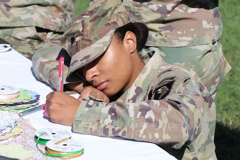 2018 Footprints on the Heart participant Spc. Kearra Murry, assigned to the 96th Aviation Support Battalion, 101st Combat Aviation Brigade, writes a note on an ornament in remembrance of her angel baby. Murry and others participated in the annual remembrance held at Blanchfield Army Community Hospital Oct. 18, 2018, in conjunction with National Pregnancy and Infant Loss Awareness Month. (U.S. Army photo by Maria Yager)