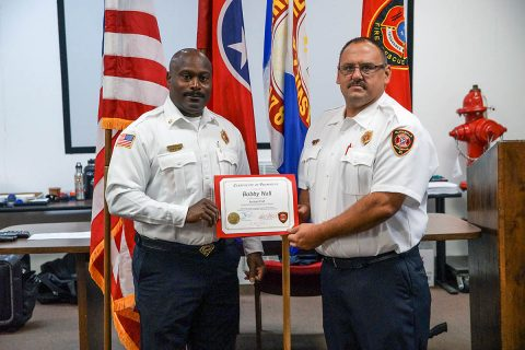 Clarksville Fire Chief Freddie Montgomery presents a Certificate of Promotion to Assistant Chief Bobby Nall, who will lead the department's Maintenance Division.