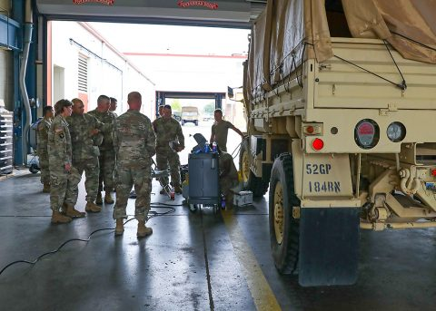 Members of the 101st Sustainment Brigade command team visit the 584th Support Maintenance Company to get a better understanding of Operation Eagle Wrench. The operation is an effort to improve vehicle and maintenance readiness across the 101st Airborne Division (Air Assault). (Sgt. Aimee Nordin, 101st Airborne Division (AA) Sustainment Brigade Public Affairs)