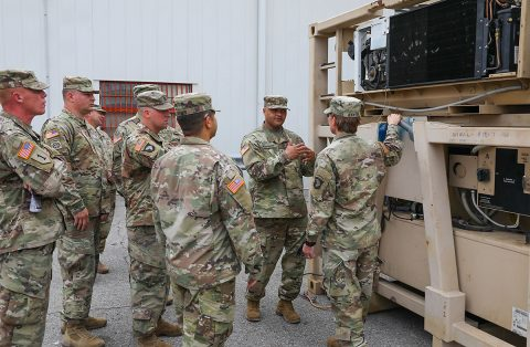 Chief Warrant Officer 4 Langston Washington (middle right), senior warrant officer, 101st Sustainment Brigade, 101st Airborne Division (Air Assault), describes to 101st Sust. Bde. senior leaders the various equipment Soldiers are using as the conduct vehicle maintenance. Col. Stephanie Barton (right), commander, 101st Sust. Bde, 101st Abn. Div. attended the tour to ensure the Soldiers has everything they need to be successful during the mission. (Sgt. Aimee Nordin, 101st Airborne Division (AA) Sustainment Brigade Public Affairs)