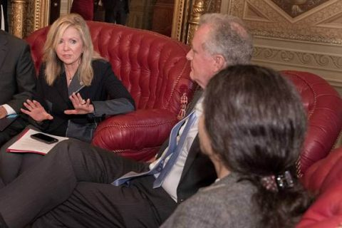 Senator Marsha Blackburn speaks with Syrian Defense Council President Ilham Ahmed.