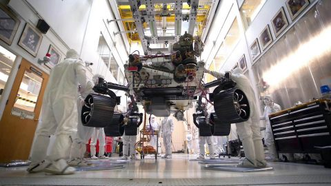 This photo taken on October 8th, 2019, at NASA's Jet Propulsion Laboratory in Pasadena, California, captures the first time the Mars 2020 rover carries its full weight on its legs and wheels. The rover was photographed in JPL's Simulator Building, where it underwent weeks of testing. (NASA/JPL-Caltech)