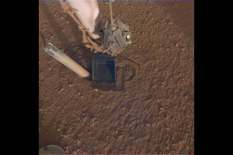 "NASA InSight Lander's heat probe, or ""mole,"" is seen after backing about halfway out of the hole it had burrowed. (NASA/JPL-Caltech)"