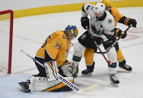 Nashville Predators goalie Pekka Rinne stops a shot on goal against the San Jose Sharks at Bridgestone Arena.(Michael Strasinger)