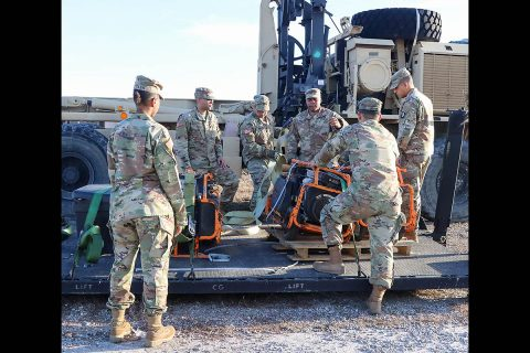 Soldiers from varying brigades and units throughout the 101st Airborne Division (Air Assault), properly secure equipment brought in to the Division Excess Consolidation Point (DECP) to a pallet, Nov. 20, as part of Operations Clean Eagle and Eagle Sweep. (Staff Sgt. Caitlyn Byrne, 101st Sustainment Brigade Public Affairs)
