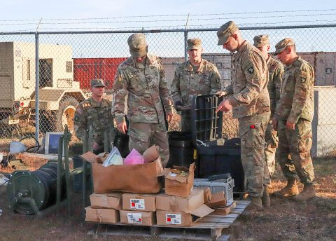 Soldiers from varying brigades and units throughout the 101st Airborne Division (Air Assault) sort through excess supplies and equipment brought in to the Division Excess Consolidation Point (DECP), Nov. 20, as part of Operations Clean Eagle and Eagle Sweep. (Staff Sgt. Caitlyn Byrne, 101st Sustainment Brigade Public Affairs)