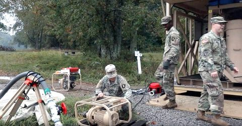 Spc. Demazio Santana (left), Spc. Keith Brown (middle) and Spc. Joshua McReynolds (right), all assigned to 227th Composite Supply Company, 129th Combat Sustainment Support Battalion, 101st Sustainment Brigade, 101st Airborne Division, perform preventative maintenance checks and services on their generators for the Lightweight Water Purification System during water purification and maintenance training at Lake Kyle, Fort Campbell, Ky., in an effort to improve mission readiness, a priority for the 101st Airborne Division. (Sgt. Aimee Nordin, 101st Sustainment Brigade Public Affairs)