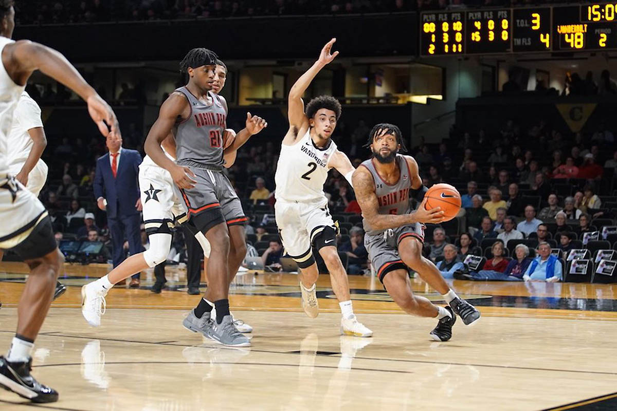 Austin Peay State University men's basketball players #21 Terry Taylor and #5 Jordyn Adams receive OVC awards. (APSU Sports Information)