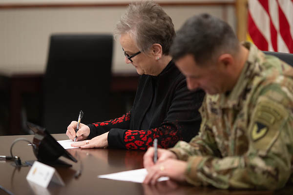 Austin Peay State University President Alisa White and Col. Jeremy Bell sign an Intergovernmental Support Agreement. (APSU)