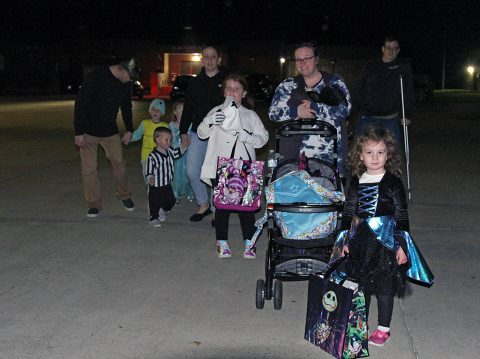 Lifeliners Soldiers and Family members walk together to the next spookily decorated vehicle, during the 101st Sustainment Brigade, 101st Airborne Division (Air Assault) Trunk-or-Treat event, here on Fort Campbell, KY, October 29, 2019. Over twenty different vehicles showed up and showed out at the event, displaying their trunks and decorating skills with a multitude of fun and spooky Halloween themes. (Staff Sgt. Caitlyn Byrne, 101st Sustainment Brigade Public Affairs)