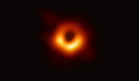 The first picture of a black hole was made using observations of the center of galaxy M87 taken by the Event Horizon Telescope. The image shows a bright ring formed as light bends in the intense gravity around a black hole 6.5 billion times the Sun's mass. (Event Horizon Telescope Collaboration)