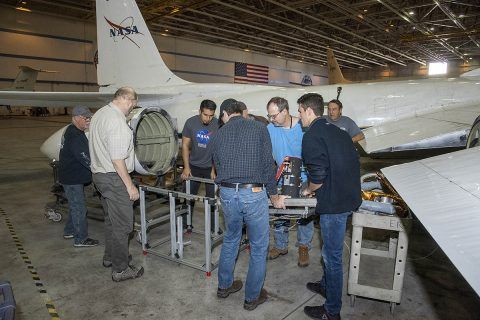 The air-LUSI crew and ground crew from NASA's Armstrong Flight Research Center in Palmdale, CA place air-LUSI's component from the wingpod to the stand for hangar calibration. (NASA Photo / Ken Ulbrich)