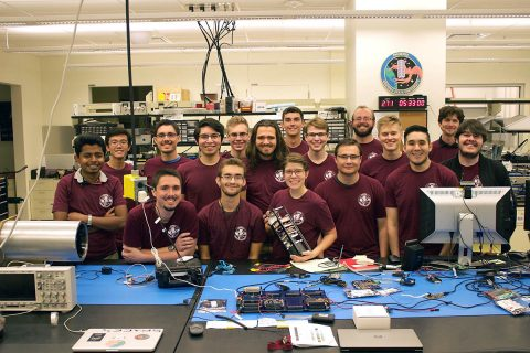Montana State University students with RadSat-u CubeSat. (NASA)