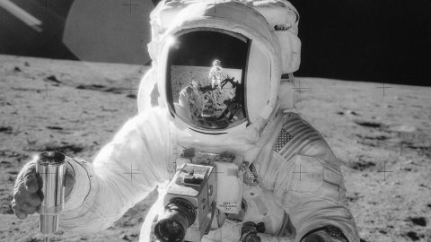 """Apollo 12 lunar module pilot Alan Bean holds a container of lunar soil, with the reflection of mission commander Charles """"Pete"""" Conrad Jr. visible on his visor. The image was taken on the Moon's Ocean of Storms on Nov. 20, 1969. Apollo 12's lunar activities included the deployment of the Apollo Lunar Surface Experiments Package (ALSEP), finding NASA's Surveyor 3 spacecraft (which landed on the Moon on April 19, 1967), and collecting 75 pounds (34 kilograms) of rock samples. (NASA)"""