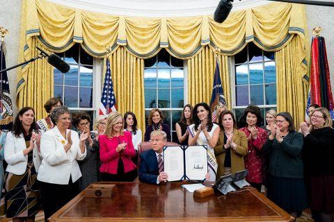 President Donald Trump signs Bill Creating Women's Suffrage Commemorative Coin. (Elizabeth Gregory)