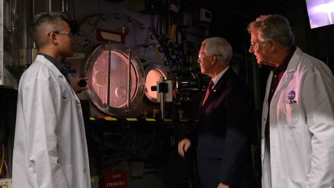 U.S. Vice President Mike Pence (center) views a test run at the Arc Jet Complex at NASA's Ames Research Center in California's Silicon Valley on Thursday, Nov. 14, 2019. Also pictured are Arc Jet Complex facility manager Peter Race (left) and Ames' Thermophysics Facilities Branch chief Scott Eddlemon (right). (NASA/Dominic Hart)
