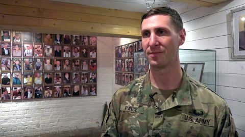 Sgt. Travis Paice of the 1st Brigade Combat Team, 101st Airborne Division shares stories of his great-grandfather, a World War II veteran, at the Bastogne Barracks in Bastogne, Belgium. Paice participated in ceremonies and a parade for the 75th commemoration of the Battle of the Bulge. (U.S. Army video screenshot by Pfc. Andrew Wash)