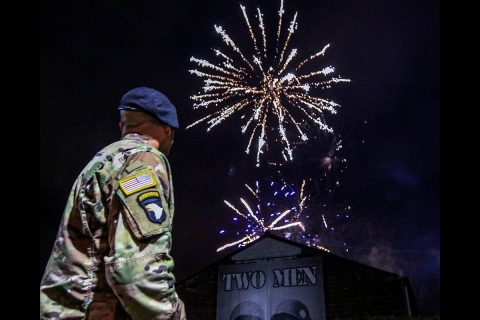 Sgt. 1st Class Rick Hurt, 1st Brigade Combat Team, 101st Airborne Division (Air Assault) honor guard, watches a firework display outside of the Belgium army Arlon barracks, Dec. 13. Nearly a million people converged on the city of Bastogne to celebrate the 75th anniversary of the Battle of the Bulge victory, fought and won, during World War II. (Pvt. John Simpson, 40th Public Affairs Detachment)