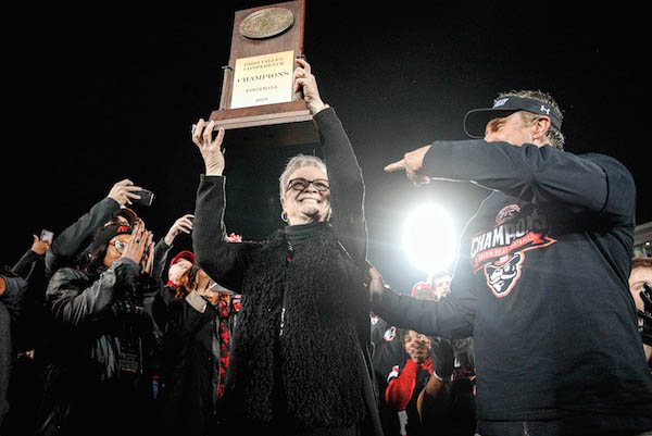 Austin Peay State University President Alisa White lifts the OVC Championship trophy. (APSU)