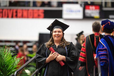 Austin Peay State University education student Sydney Funk cradles her diploma. (APSU)
