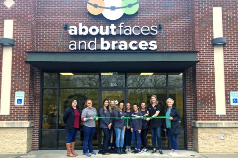 About Faces and Braces Green Ribbon Cutting ceremony. (L to R) Jessica Banker, Haley Randell, Nevada Miranda, Mahaila Leavell, Jeannine Rivera-Mayle, Jada Dowlen, Daniela Mejorado, Casey Tayloe, Dr. Candice Coleman and Melinda Shepard