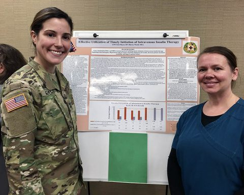 U.S. Army Capt. Tori Meyer, a registered nurse, and federal employee Sherry Wood, a medical support assistant, both from Blanchfield Army Community Hospital, Fort Campbell, Kentucky, presented their team's research project during the hospital's Nursing Round-Up. (U.S Army photo by Maria Yager)