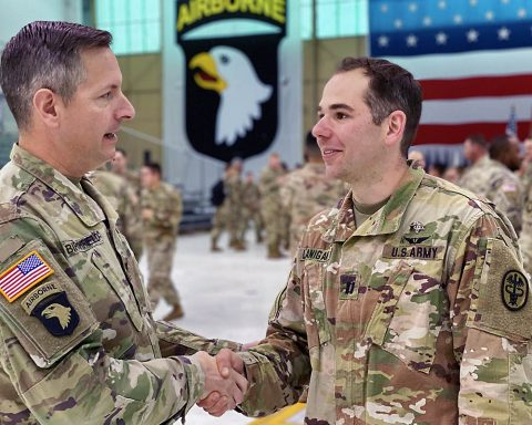 Blanchfield Army Community Hospital Commander, Col. Patrick T. Birchfield, congratulates BACH Otolaryngologist Capt. Alexander Lanigan for earning the Army's Expert Field Medical Badge during an EFMB qualification on Fort Campbell, Kentucky, Nov. 15 - 27, sponsored by the 101st Airborne Division (Air Assault). (U.S. Army photo by Maria Yager)