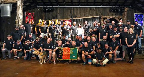 Veterans of B Company, 2nd Battalion, 504th Parachute Infantry Regiment, 82nd Airborne Division, Fort Bragg, North Carolina, pose for a group picture during a unit reunion, organized with the help of the Independence Fund, in Nashville, Tennessee, September 26-29. (Staff Sergeant Michael Eaddy, 3rd Brigade Combat Team, 101st Airborne Division (AA) Public Affairs)