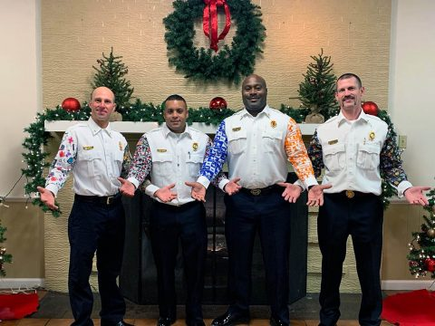 Clarksville Fire Rescue Chief Freddie Montgomery, third from left, shows off his holiday party sleeves -- one for Kentucky and one for Tennessee -- along with other honorees Saturday at the Hopkinsville Fire Department's annual award ceremony. HFD announced the Montgomery Award in his honor during the event.