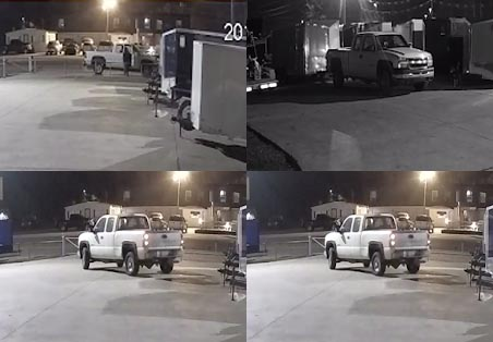 Clarksville Police has release these four photos of the suspects pulling onto the lot and backing up to the trailer they stole.