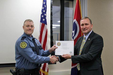 Montgomery County Sheriff John Fuson congratulates Collin Trout.