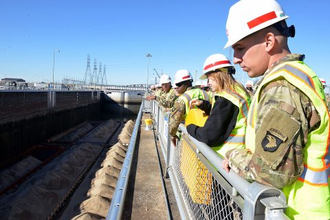 A group of Soldiers from Fort Campbell's 326th Engineer Battalion, 101st Airborne Division watch a barge lock through at the Kentucky Lock Addition Project in Grand Rivers, KY. (Mark Rankin, U.S. Army Corps of Engineers, Nashville District)