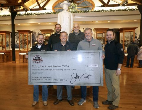 Pictured from L-R (front row): Brown-Forman's Mike Galvin, Charlie Williams, COO ASYMCA, Jack Daniel's Master Distiller Jeff Arnett and Assistant Master Distiller Chris Fletcher, (Back Row) Jack Daniel's National Sponsorship Director Greg Luehrs and Director of Lynchburg Homeplace, Steve May, recently presented a check in the amount of $22,842.50 to the Armed Services YMCA at the Jack Daniel's Visitor Center in Lynchburg, TN.