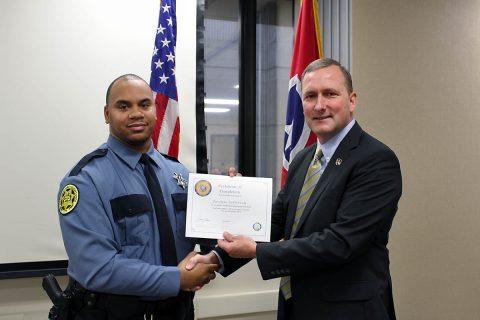 Montgomery County Sheriff John Fuson congratulates Javonte Jefferson.