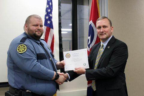 Montgomery County Sheriff John Fuson congratulates Michael Wall.