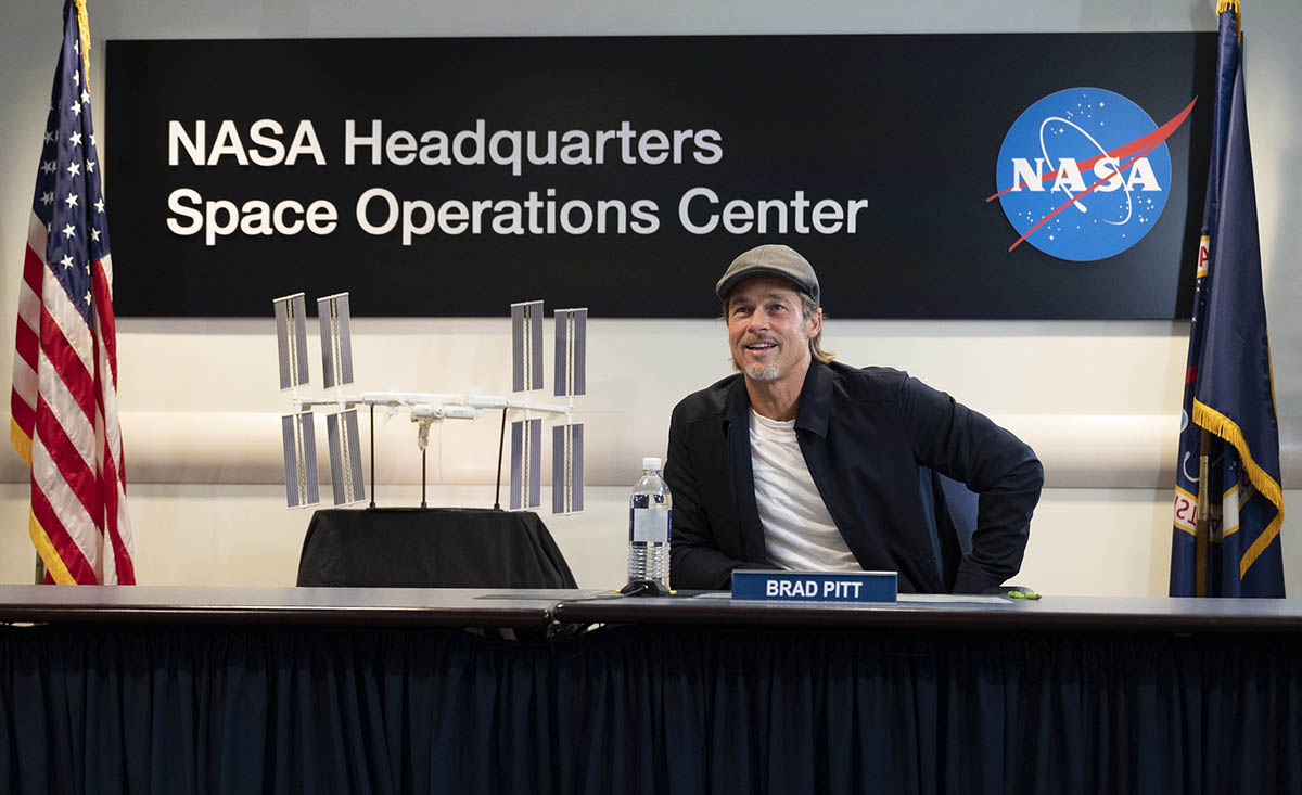 """Actor Brad Pitt talks to NASA astronaut Nick Hague who is onboard the International Space Station, Sept. 16, 2019, from the Space Operations Center at NASA Headquarters in Washington. Pitt, who stars as an astronaut in his latest film """"Ad Astra,"""" spoke with Hague about what it's like to live and work aboard the orbiting laboratory. (NASA/Joel Kowsky)"""