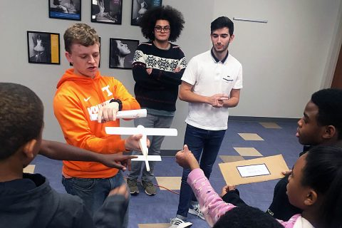 Research students from the University of Tennessee, who during 2019 worked to design an ultra-efficient wing as part of the school's University Leadership Initiative project, explain airplane control surfaces to students at the Regal Boys & Girls Club in Knoxville, TN. (Hans Sati Goertz, University of Tennessee)