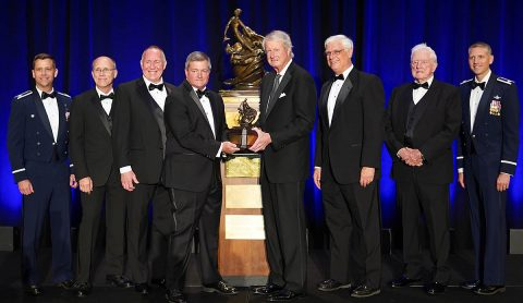 The Automatic Ground Collision Avoidance System Team accepted the Collier Trophy on June 13, 2019. From left to right: Col Robert Ungerman, Mark Skoog, Ed Griffin, Mark Wilkins, Jim Albaugh, Greg Principato, Donald Swihart, and Lt Col Tucker Hamilton. (National Aeronautic Association)