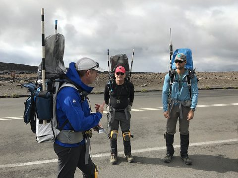 Members of the BASALT team wear backpacks designed for astronauts, during a Mars mission simulation in Hawaii Volcanoes National Park in November 2017. The packs carry technology tools for relaying information between the explorers in the field and scientists at the simulation's Earth-based mission support center. Pictured, from left to right, are: Steve Chappell, BASALT exploration lead and a research specialist at NASA's Johnson Space Center in Houston; Rick Elphic, a planetary scientist at NASA's Ames Research Center in California's Silicon Valley; and Mike Miller, telescience research and technology lead, from Kennedy Space Center, in Florida. (NASA)