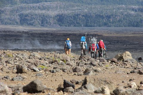 A team sets off across the volcanic terrain on Hawaii's Kilauea volcano during the BASALT project's November 2017 field campaign. They tested navigation and data transmission tools for future astronauts and collected geological and biological samples for the project's science team, all under realistic communications delays and bandwidth limitations that missions will really experience on Mars. (NASA)
