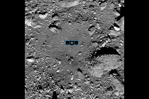 This image shows sample site Nightingale, OSIRIS-REx's primary sample collection site on asteroid Bennu. The image is overlaid with a graphic of the OSIRIS-REx spacecraft to illustrate the scale of the site. (NASA/Goddard/University of Arizona)